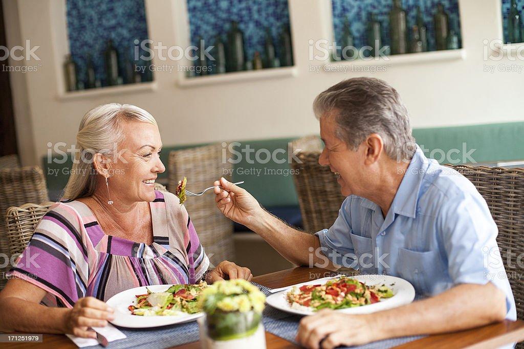 Senior couple eating together royalty-free stock photo