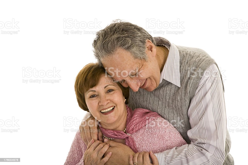 Senior couple embracing and smiling stock photo
