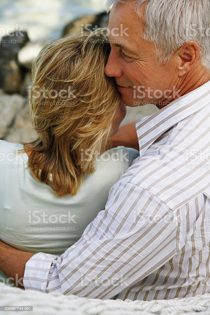 Senior couple embracing, rear view, close-up royalty-free stock photo
