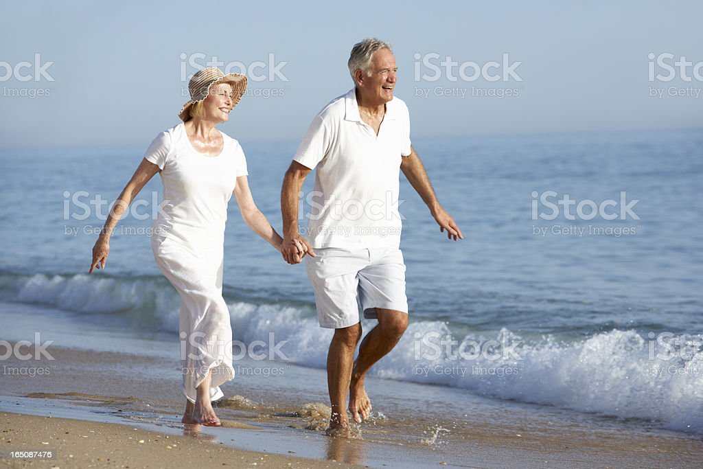 Senior Couple Enjoying Beach Holiday royalty-free stock photo