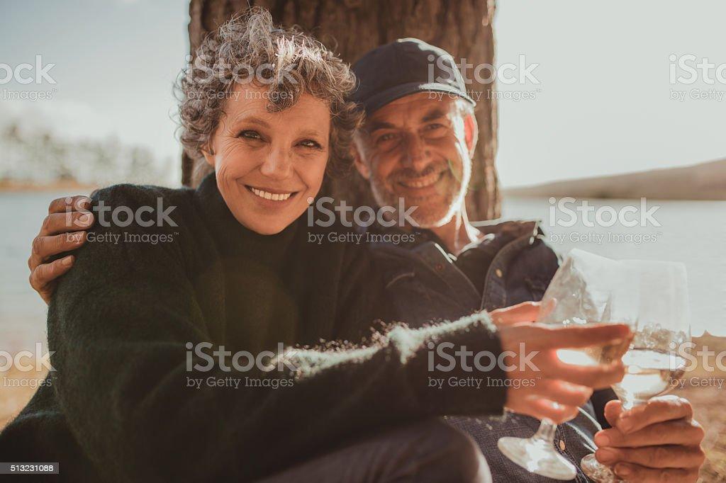 Senior couple enjoying camping holiday stock photo