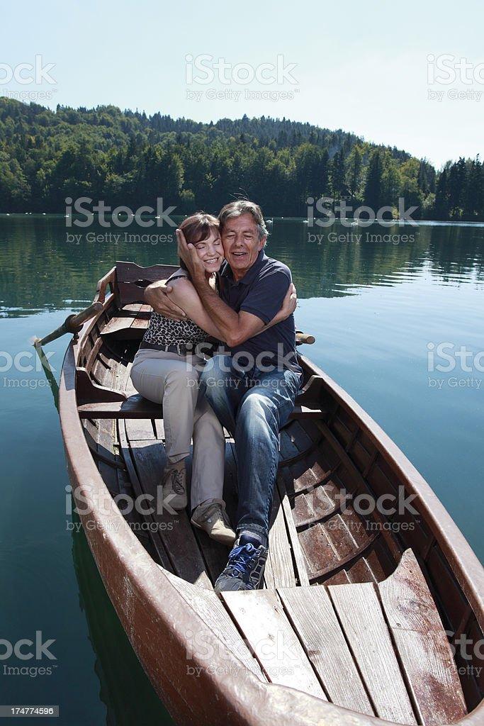 Senior couple enjoying day on the lake royalty-free stock photo