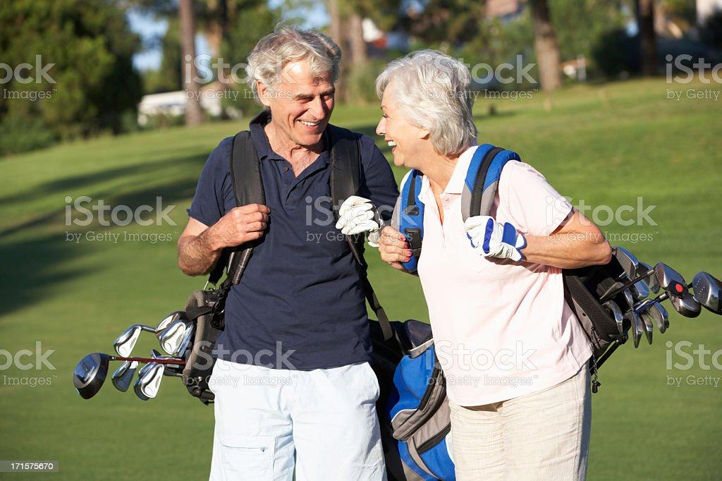 Senior Couple Enjoying Game Of Golf stock photo