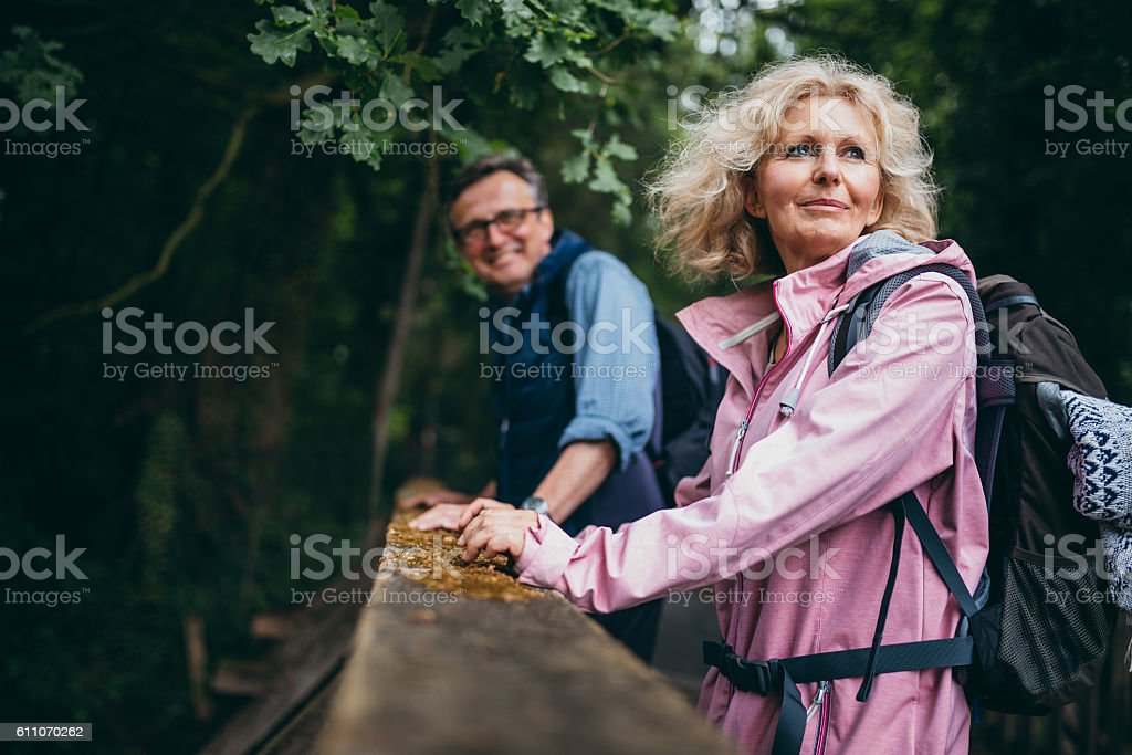 Senior Couple enjoying hike in the forest stock photo