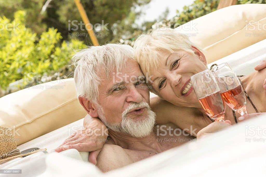 Senior couple enjoying into jaccuzi royalty-free stock photo