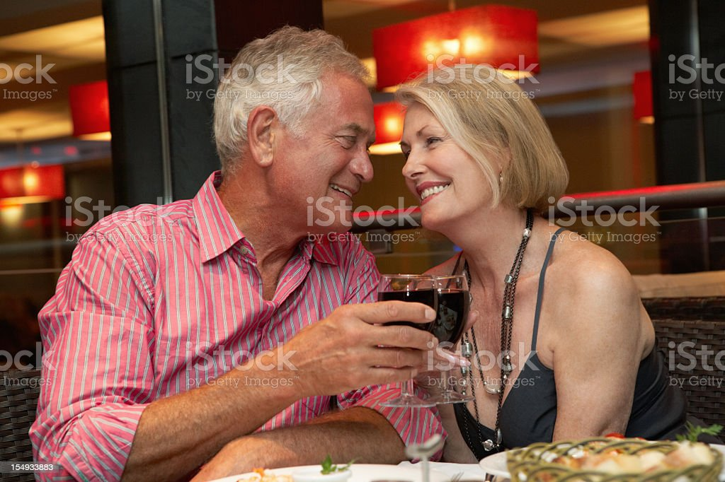 Senior Couple Enjoying Meal In Restaurant royalty-free stock photo