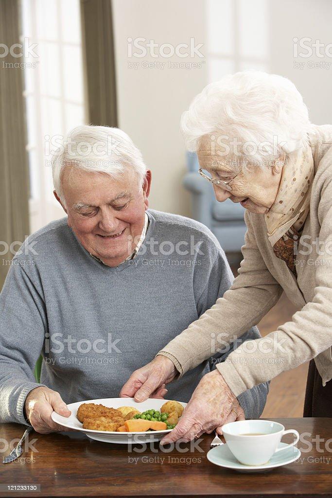 Senior Couple Enjoying Meal Together royalty-free stock photo