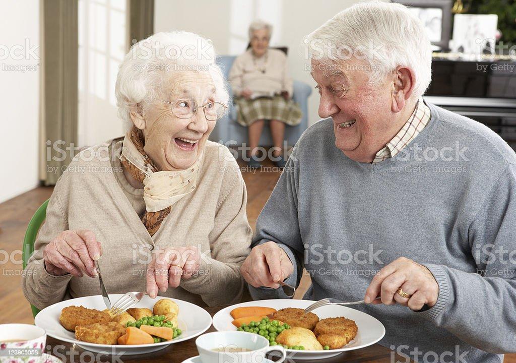 Senior Couple Enjoying Meal Together stock photo