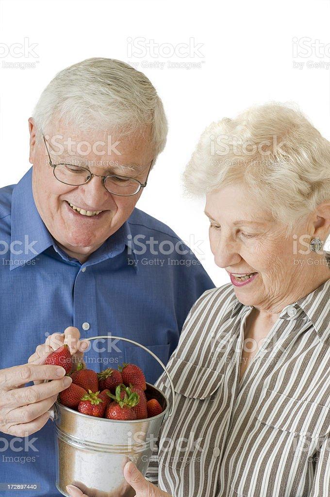 Senior Couple Enjoying Newly Picked Strawberries stock photo