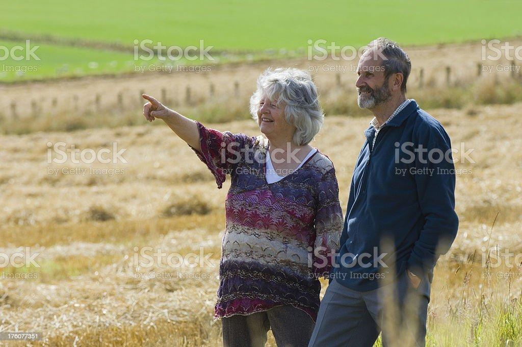 Senior couple enjoying the outdoors royalty-free stock photo