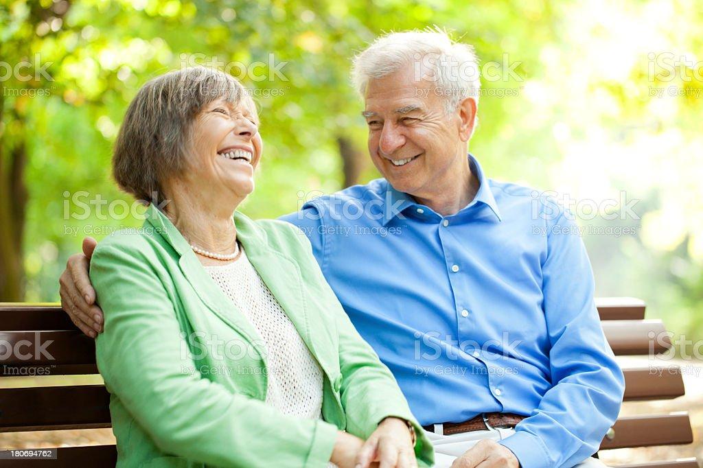 Senior couple enjoying time together at the park stock photo