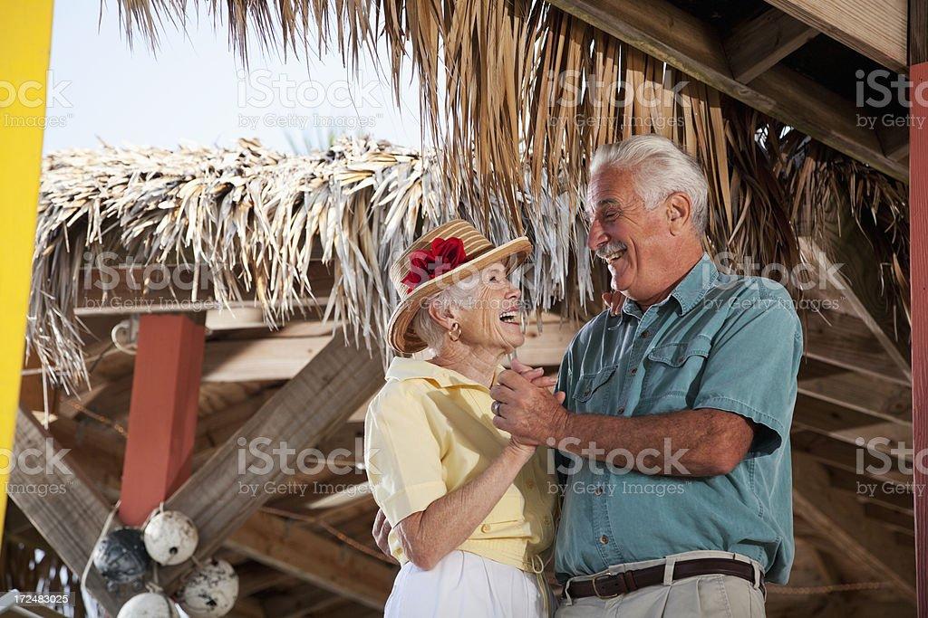 Senior couple enjoying tropical holiday royalty-free stock photo