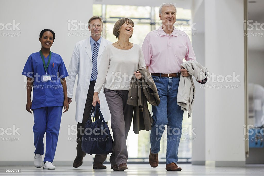Senior Couple entering Hospital stock photo