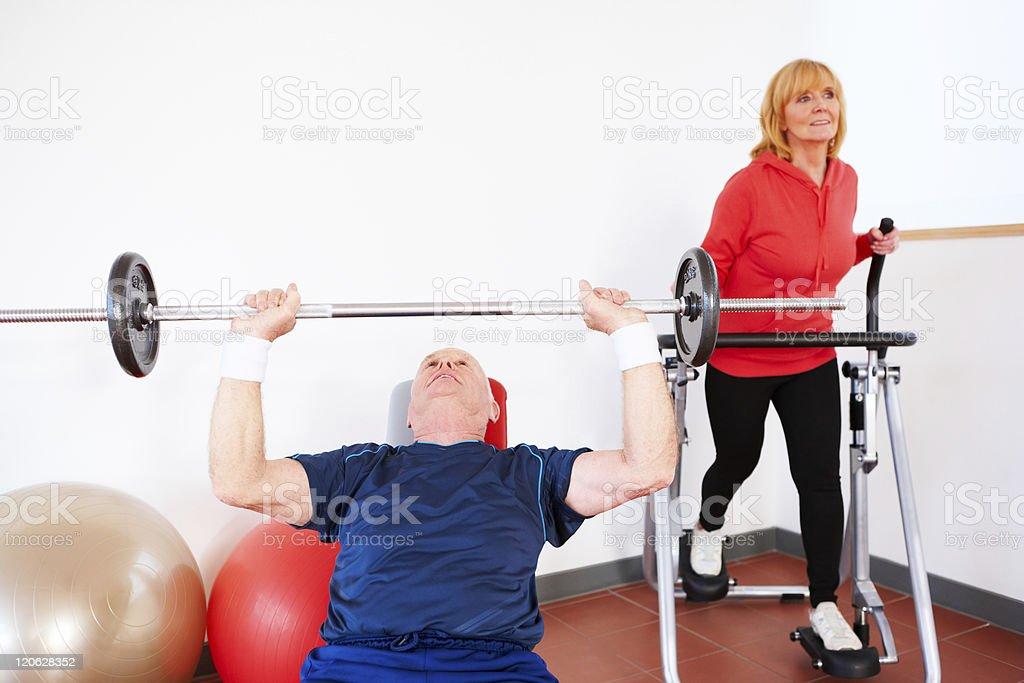 Senior Couple Exercising at the Gym royalty-free stock photo