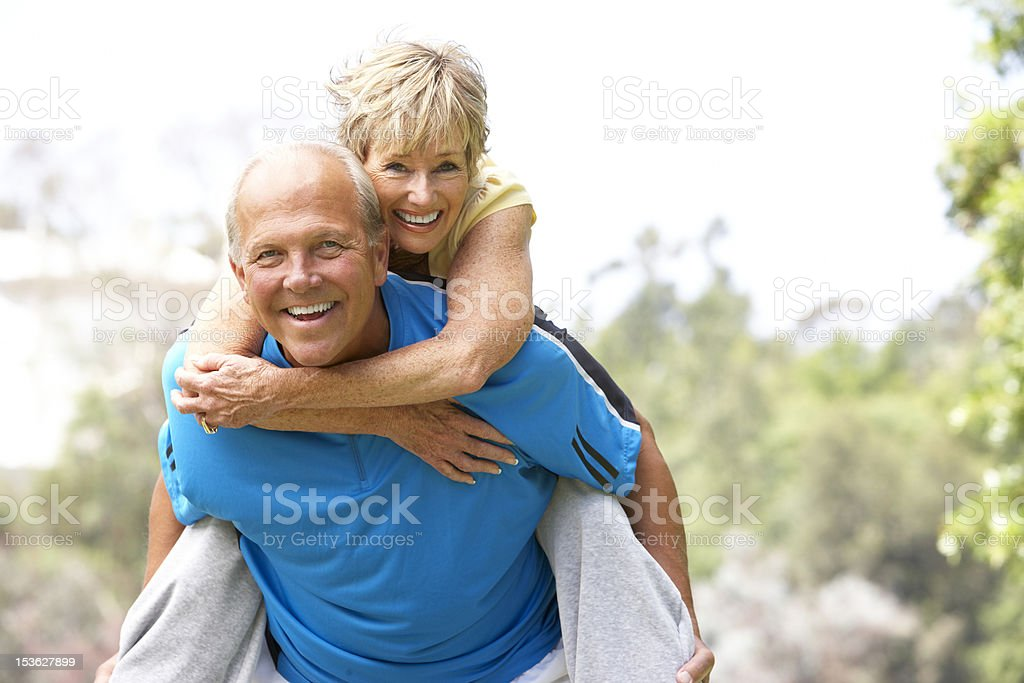 Senior Couple Exercising In Park stock photo