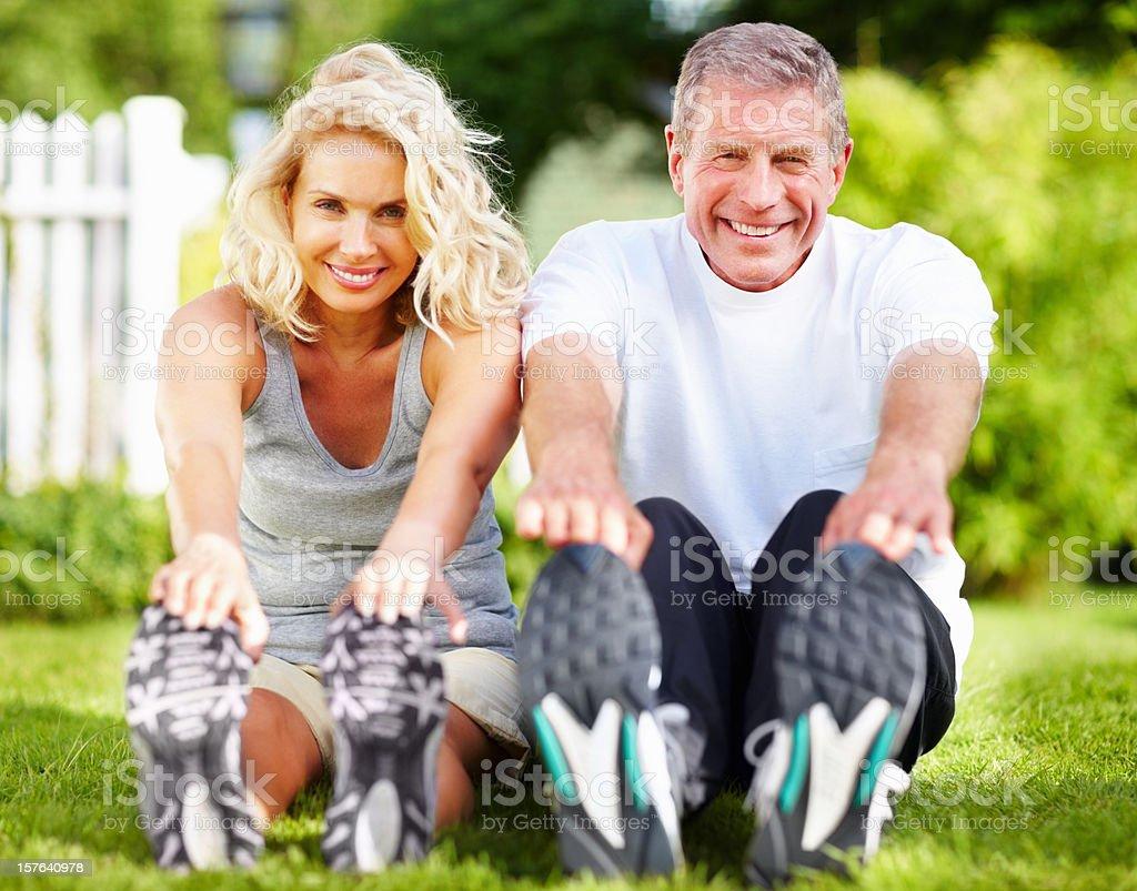 Senior couple exercising in park royalty-free stock photo