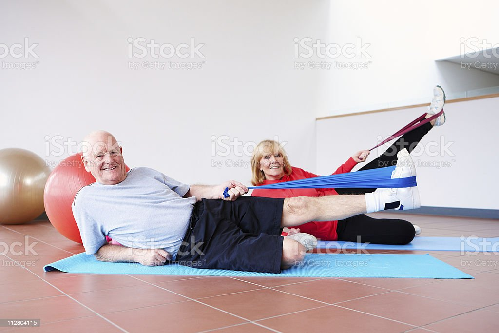 Senior Couple Exercising with Resistance Bands stock photo