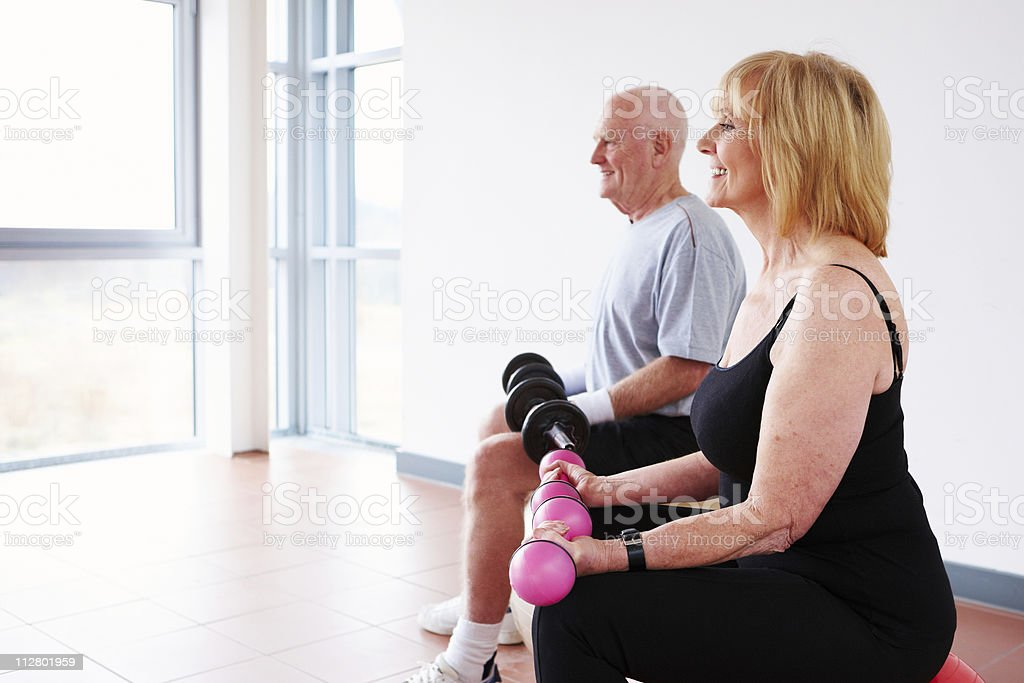 Senior Couple Exercising with Weights royalty-free stock photo