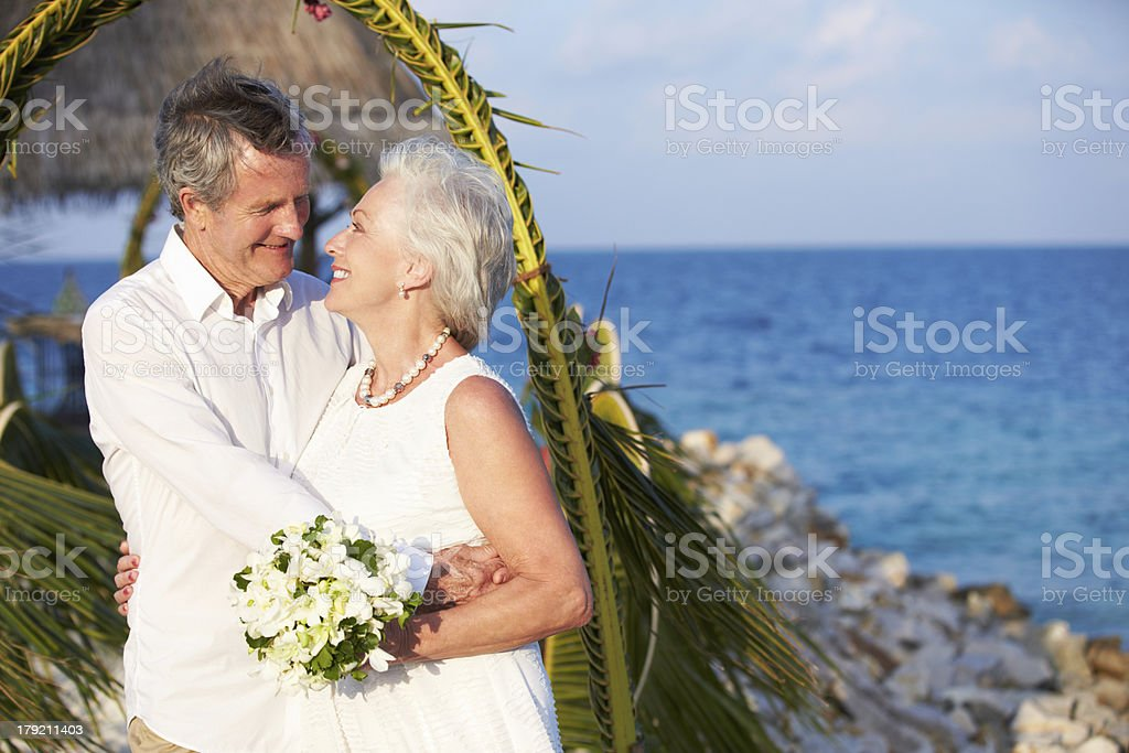 Senior Couple Getting Married In Beach Ceremony stock photo
