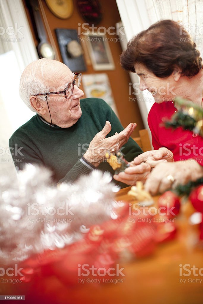 Senior couple getting ready for Christmas royalty-free stock photo
