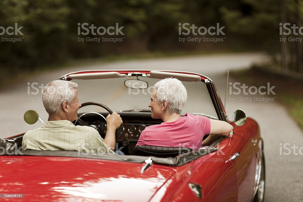 Senior Couple Going For a Drive, Rear View stock photo