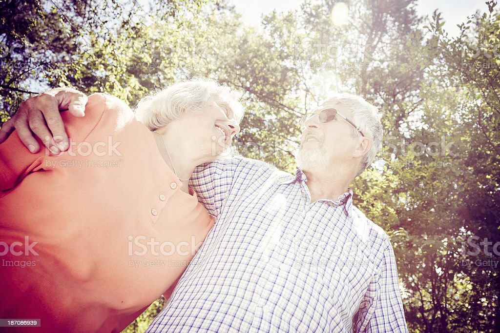 senior couple going for a walk in the forest royalty-free stock photo
