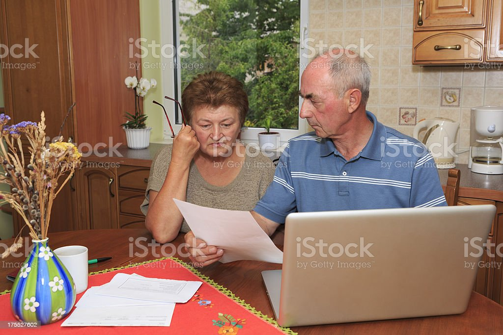 Senior couple going over bills stock photo