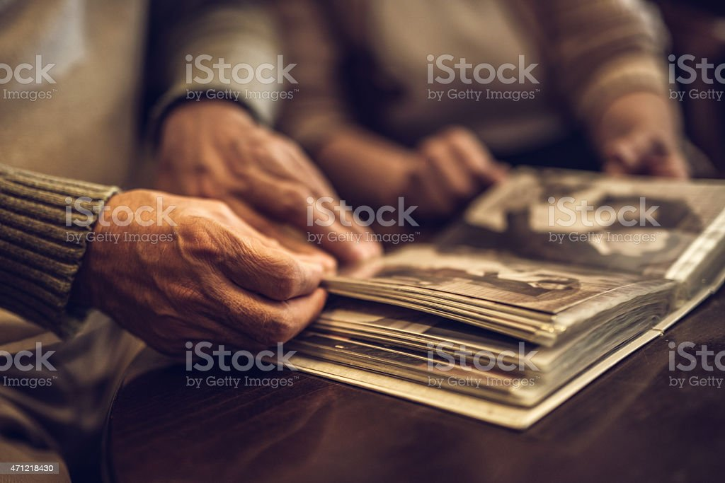 Senior couple going through old photograph album stock photo