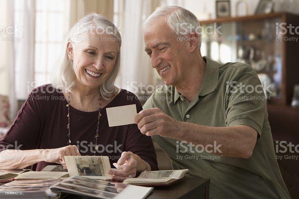 Senior couple going through photo album royalty-free stock photo