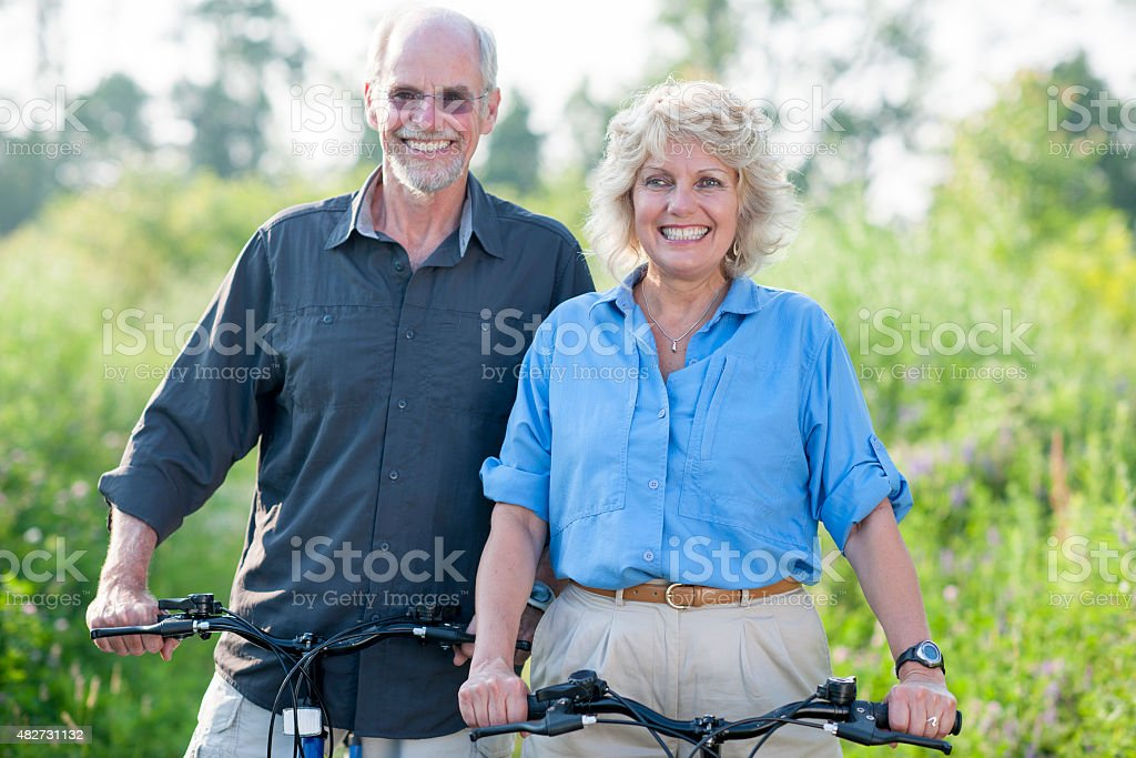Senior Couple Gone Bike Riding stock photo