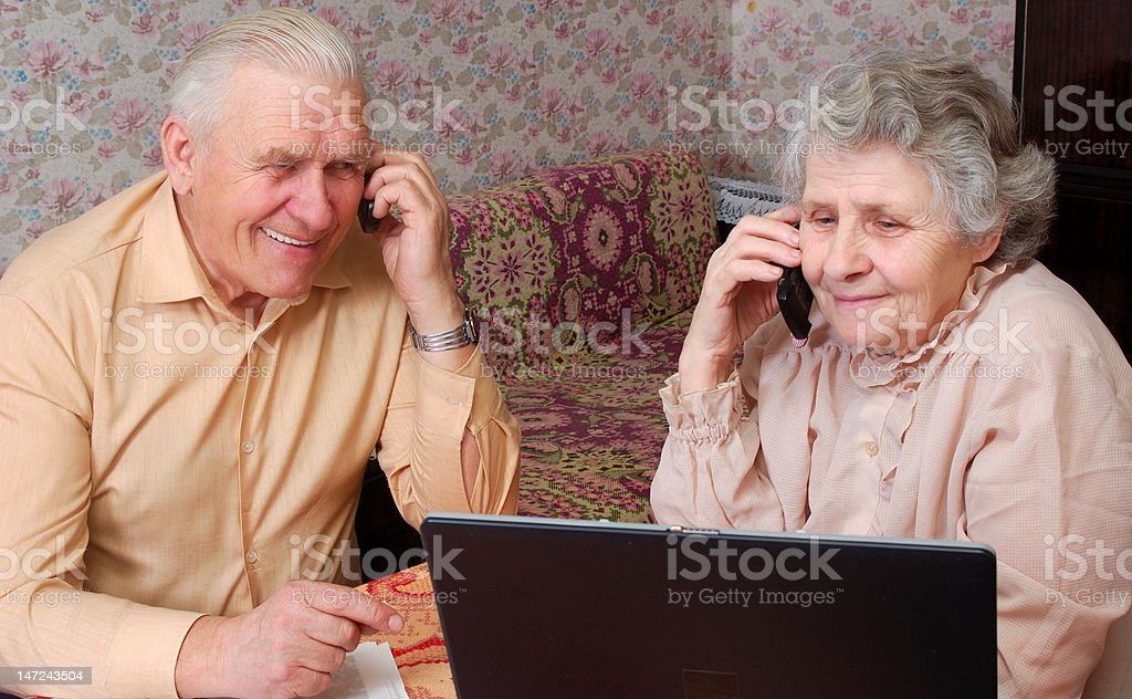 senior couple gossip about something by phone royalty-free stock photo