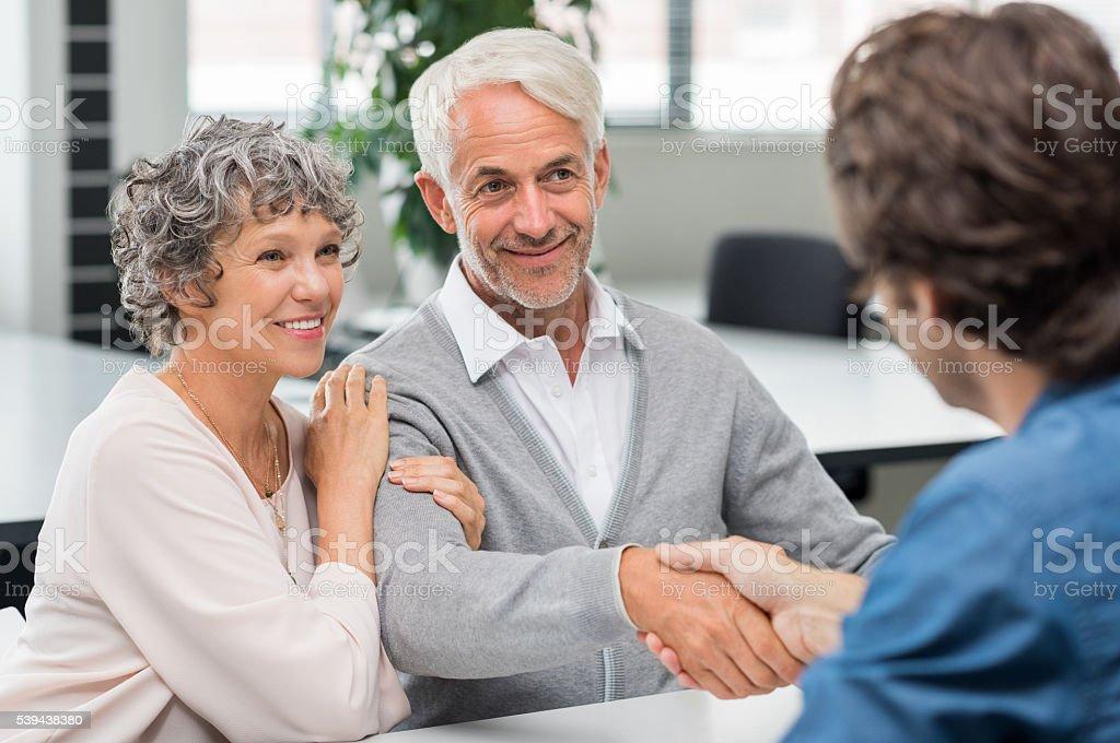 Senior couple handshake stock photo