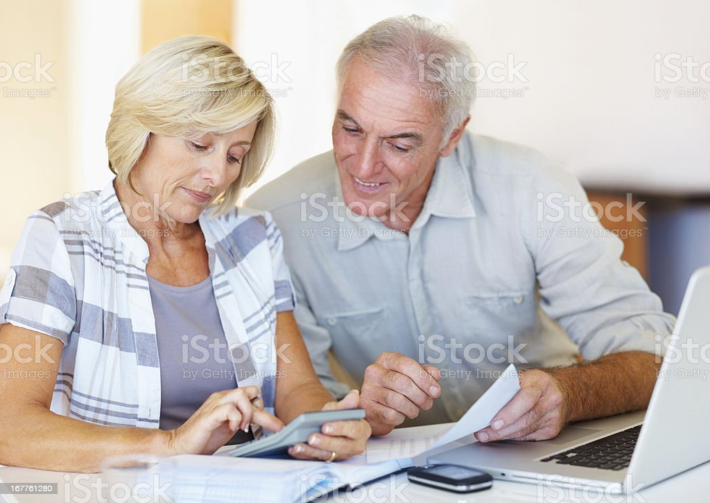 Senior couple happy about their budgeting royalty-free stock photo