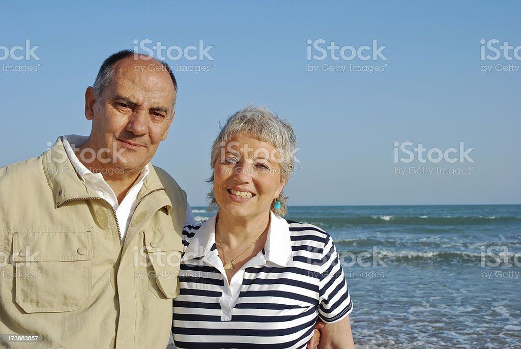 Senior couple happy at the beach royalty-free stock photo