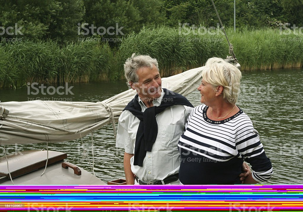Senior Couple happy with Boat royalty-free stock photo