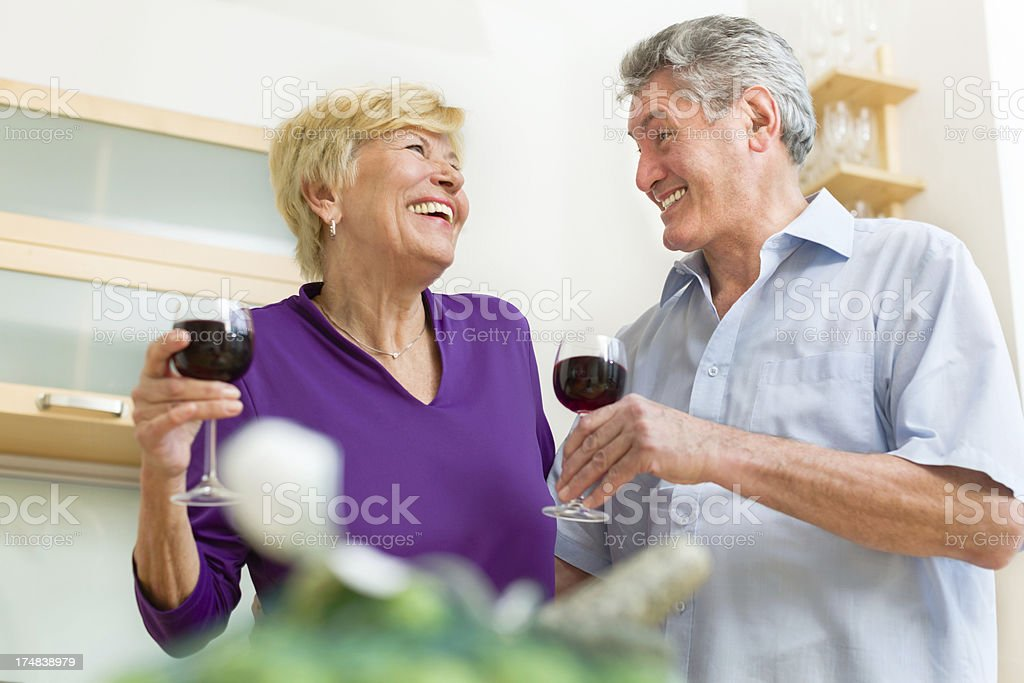 Senior couple having a conversations with a glass of a wine royalty-free stock photo