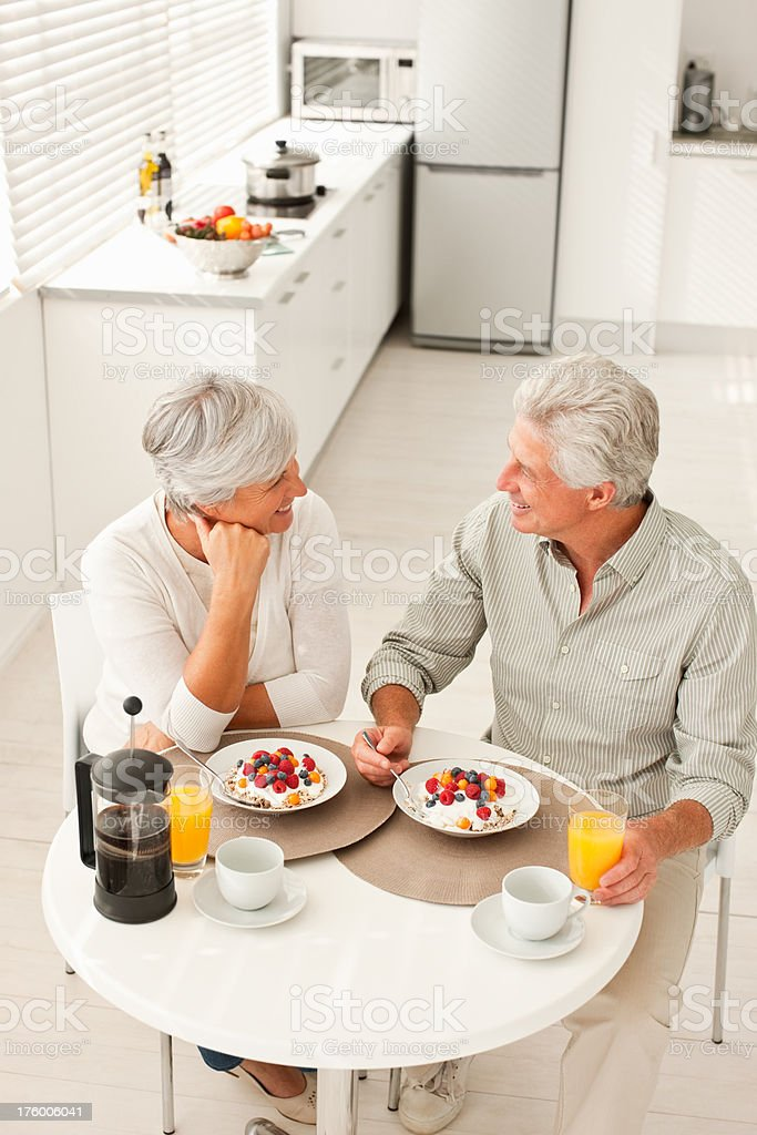 Senior couple having breakfast at home royalty-free stock photo