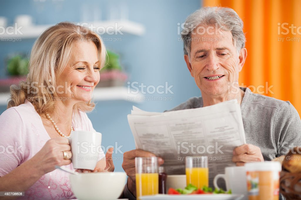 Senior couple having breakfast. stock photo