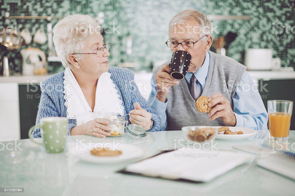 Senior couple having breakfast together stock photo