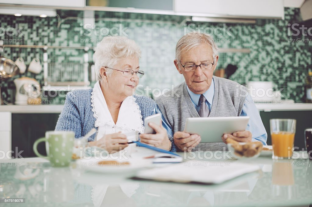 Senior couple having breakfast together stock photo