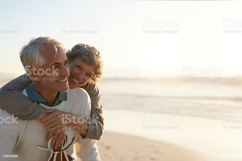 Senior couple having fun at the beach stock photo