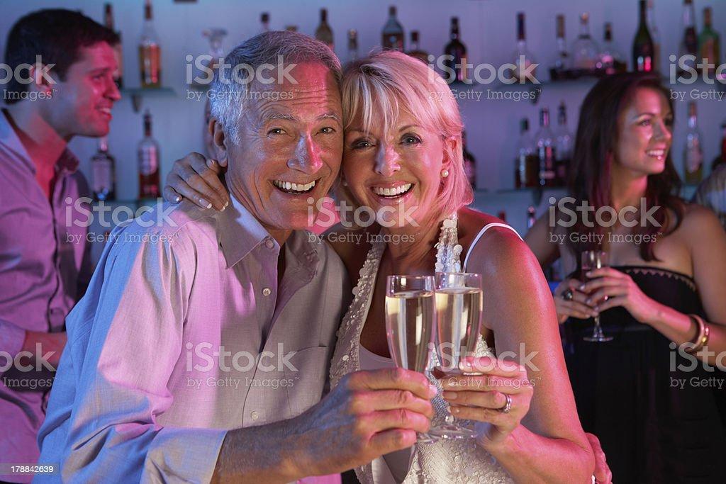 Senior Couple Having Fun In Busy Bar royalty-free stock photo