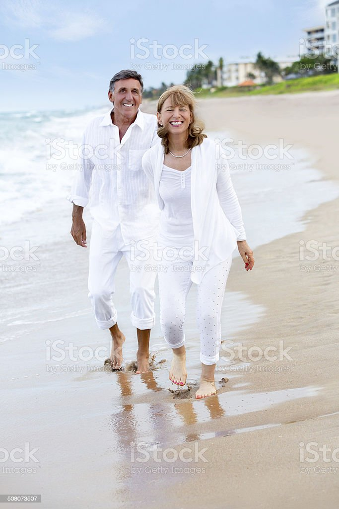 Senior couple having fun on the beach royalty-free stock photo