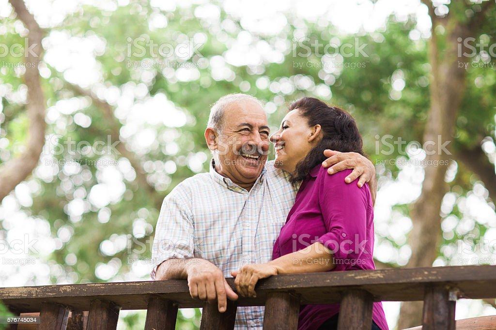 Senior couple having fun outdoors stock photo