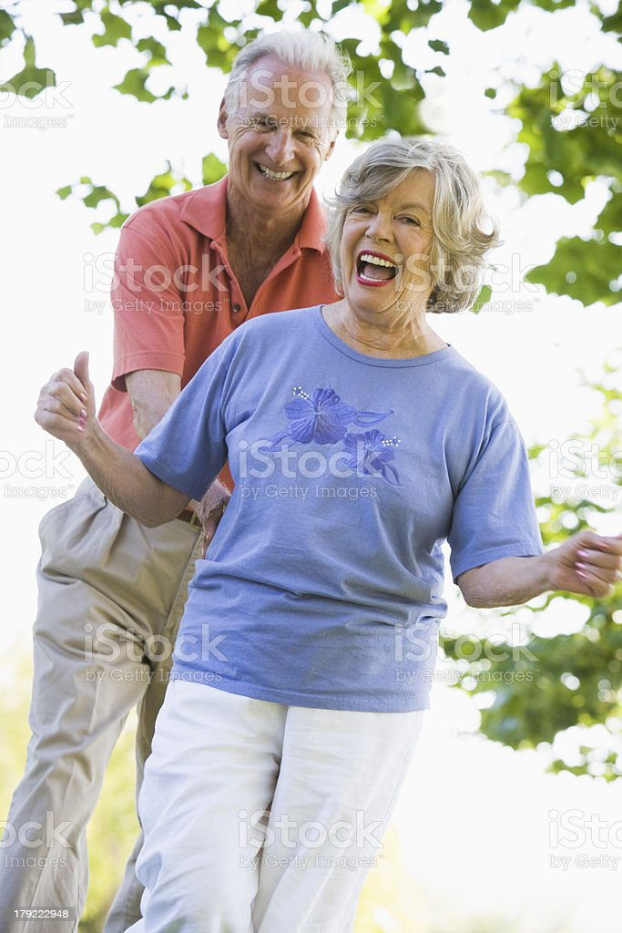Senior couple having fun outside royalty-free stock photo