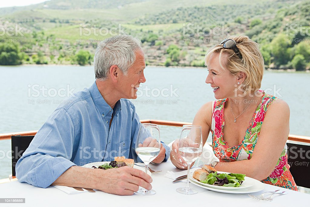 Senior couple having lunch on a boat holiday royalty-free stock photo