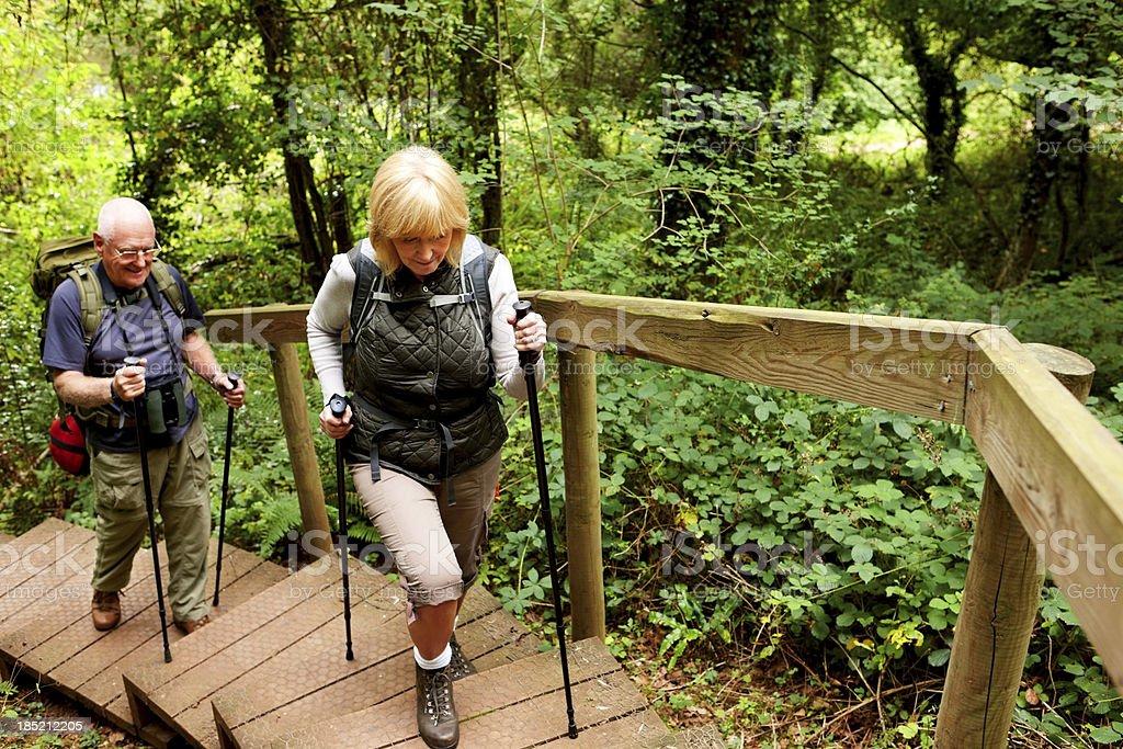 Senior couple hiking across countryside stock photo