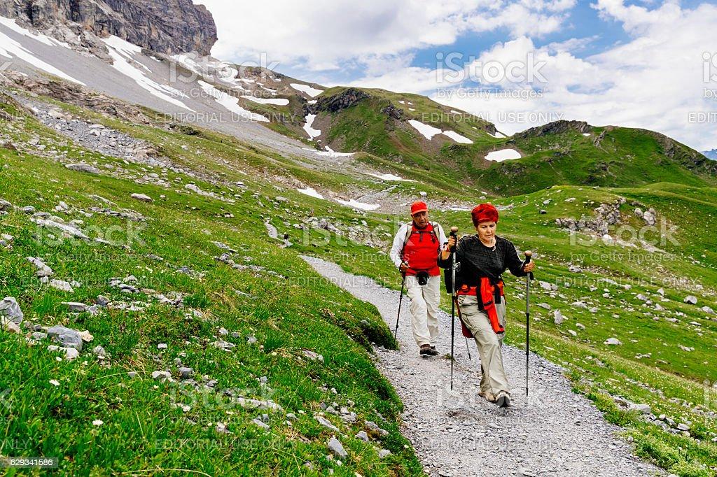 Senior couple hiking Eiger Trail, Switzerland stock photo