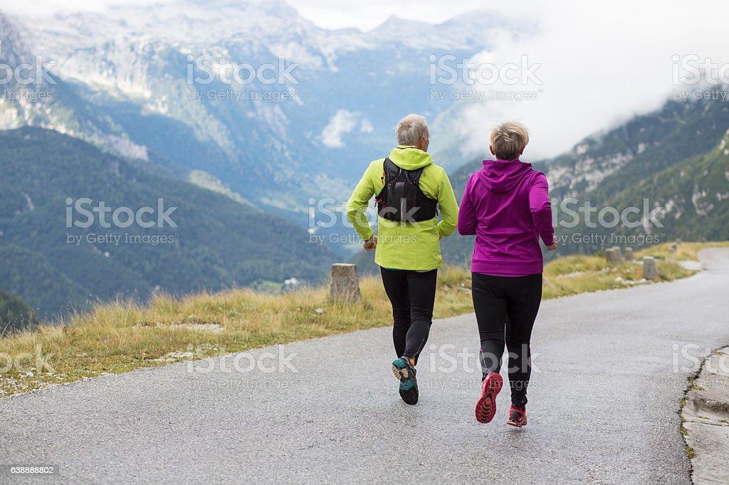 Senior couple hiking on road stock photo