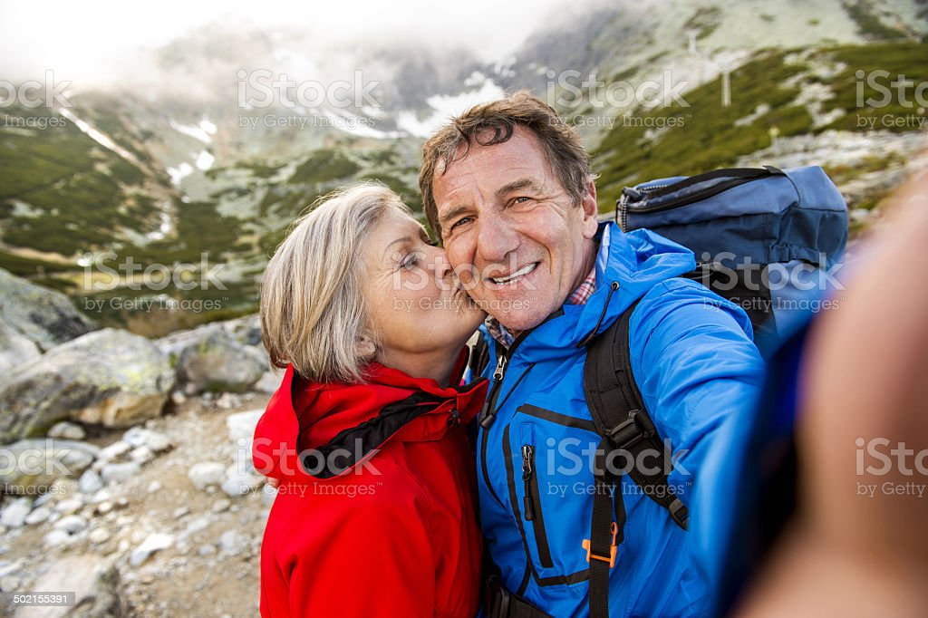 Senior couple hiking stock photo